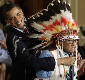President Obama reaches arpound Chief Joseph